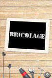 Bricolage against tools and tablet on wooden background Stock Photos