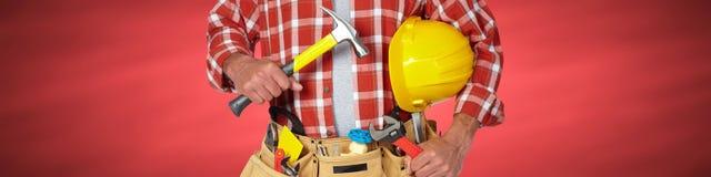 Bricoleur de constructeur avec des outils de construction photo stock