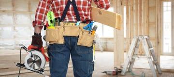 Bricoleur de constructeur avec la scie électrique Image libre de droits