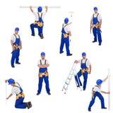 Bricoleur ou ouvrier dans différentes positions fonctionnantes photo stock