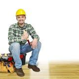 Bricoleur sur l'étage en bois photographie stock libre de droits
