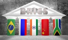 BRICS -五面主要涌现的国民经济成员旗子的协会在齿轮的 库存图片