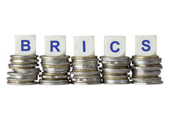 BRICS - Brazil, Russia, India, China and South Africa. Stacks of coins with the letters BRICS isolated on white background Stock Photos