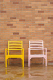 Bricyellow and pink chairs on ancient red brick Royalty Free Stock Photography