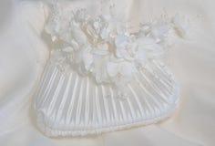 Bridal Accessories. Headpiece and satin handbag Stock Photos
