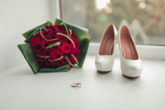 Bridal accessories bouquet, shoes and wedding rings Royalty Free Stock Images