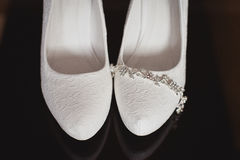 Bridal accessories: wedding shoes, jewelry and rings Royalty Free Stock Photo