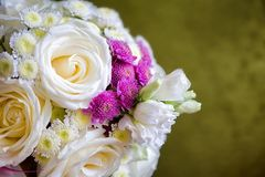 Beautiful wedding bouquet of white, pink and ultra violet flowers place for text. Stock Photos