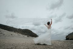 The bridal beautifully veils evolving in the wind at the coast