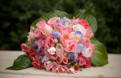 Bridal boquet. Wedding flowers from a bridal boquet with a shallow depth of field on the front flowers Royalty Free Stock Image