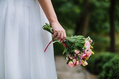 Boquet of rose flowers in bride hand. Bridal boquet of rose flowers in bride hand Royalty Free Stock Photo