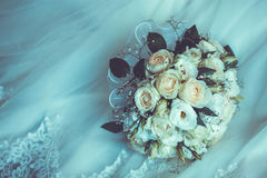 Bridal Boquet on the white wedding dress. Close up Stock Images
