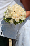 Bridal Bouquet 1. Bride holding bouquet as she greets guests Stock Photos