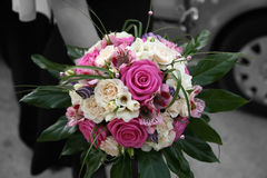 Bridal bouquet. A woman holding wedding bouquet Royalty Free Stock Photos