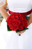 Bridal bouquet. Detail shot of bride holding her rose bouquet at wedding Royalty Free Stock Photography