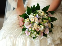 Bridal bouquet. In the hands of the bride Royalty Free Stock Photos
