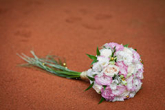Bridal bouquet. On the red surface Stock Images