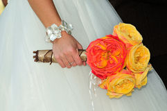 Bridal bouquet. Closeup of a wedding bride carrying a bridal flower bouquet Stock Photography