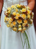 Bridal bouquet. Bride holding her bridal bouquet of yellow roses royalty free stock images
