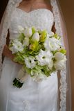 Bridal Bouquet. Bride holding a beautiful hand-tied style bouquet of white and pale yellow flowers Stock Photography