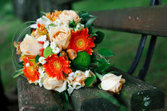 Bridal bouquet. A wonderful bridal bouquet on a park bench Stock Images