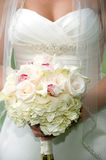 Bridal bouquet. Beautiful bridal bouquet being held by a bride on her wedding day Stock Photo
