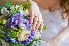 Bridal bouquet. Bride's bouquet and her hand with a wedding ring Royalty Free Stock Photography