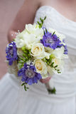 Bridal bouquet. Of fresh flowers in Bride's hands Stock Image
