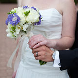 Bridal bouquet. Of fresh flowers in Bride's hands Royalty Free Stock Photography