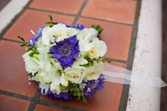 Bridal bouquet. Of fresh flowers on the tile floor Stock Photography