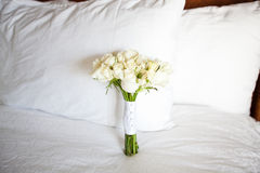 Bridal bouquet. Of fresh flowers on the bed Stock Photography