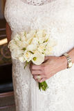 Bridal bouquet. Of fresh flowers in Bride's hands Royalty Free Stock Image