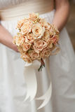 Bridal bouquet. Of fresh rose flowers in bride's hands. Selective focus Royalty Free Stock Photos