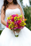 Bridal bouquet. A bridal bouquet in red, pink, green, and orange Stock Photos