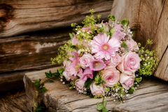 Bridal bouquet. On an old wooden board against a wall of timber Stock Photos