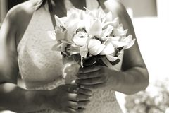Bridal Bouquet. Sepia image of close up of the bride's boquet in her hand Stock Photo