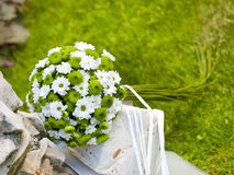 BRIDAL BOUQUET. Wedding bouquet or centerpiece rests on chair Royalty Free Stock Images