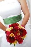 Bridal bouquet. A closeup of a bride's hands, holding her bridal bouquet Stock Photography