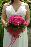 Bridal bouquet. Bride holding her pink rose bouquet Royalty Free Stock Images