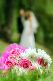 Bridal bouquet on a background of blurred silhouette of a bride. With the groom Royalty Free Stock Images