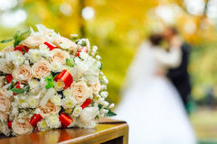Bridal bouquet on a background of blurred silhouette of a bride. With the groom Stock Photography