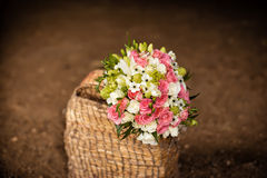 Bridal bouquet in basket Stock Photos