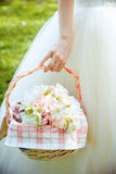 Bridal bouquet in the basket. Wedding gentle bouquet in a basket holding bride hand Royalty Free Stock Image
