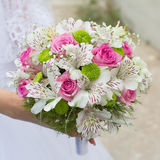 Bridal bouquet. Beautiful bouquet in hand of bride Stock Photography