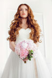 Bridal bouquet beautiful of pink wedding flowers in bride hands Stock Photography