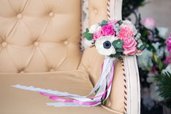 Bridal bouquet on a beige sofa Royalty Free Stock Photography