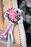 Bridal bouquet on a beige sofa Stock Image