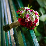 Bridal bouquet  on a bench Royalty Free Stock Photo