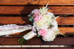 Bridal bouquet on the bench Royalty Free Stock Photo