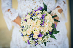 Bridal bouquet with blue flowers and white rose Stock Photography